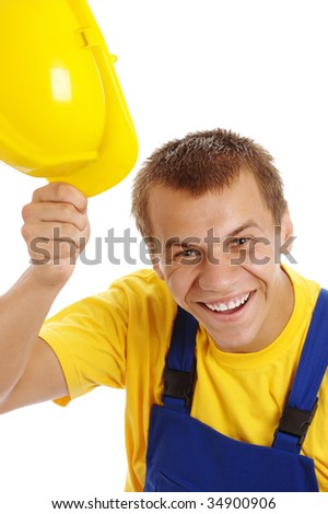 Happy young worker take off his yellow hard hat, isolated over white - stock photo