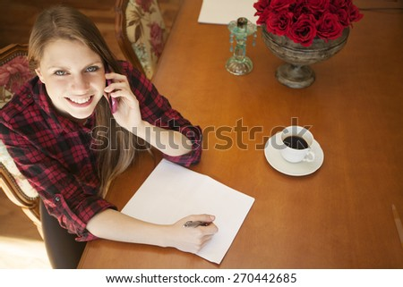 Happy young young on the phone, working at home - stock photo