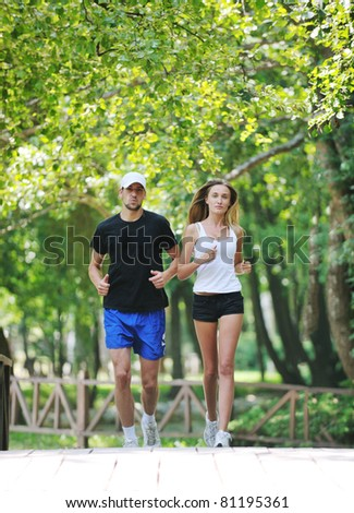 happy young younpe jogging and runing outdoor in nature at sunny day