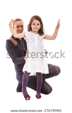 Hapy mother with dancing girl isolated on white background - stock photo