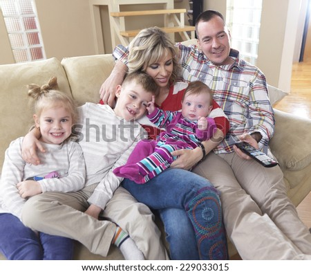 hapy young family have fun  with their children at modern living room home indoors - stock photo