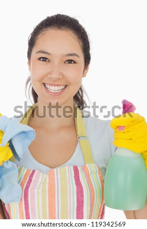 Hapyp woman in apron holdig spray bottle and rag - stock photo