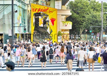 HARAJUKU, TOKYO - JULY 26, 2014: Pedestrian crossing or crosswalk in the corner of La Foret Harajuku department store and Tokyu Plaza shopping complex in Omotesando - Harajuku area. - stock photo