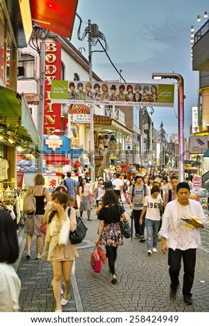 HARAJUKU, TOKYO - JULY 26, 2014: Takeshita Street, pedestrian street with a lot of shops, densely standing side by side. Main target customers are early teenagers. - stock photo