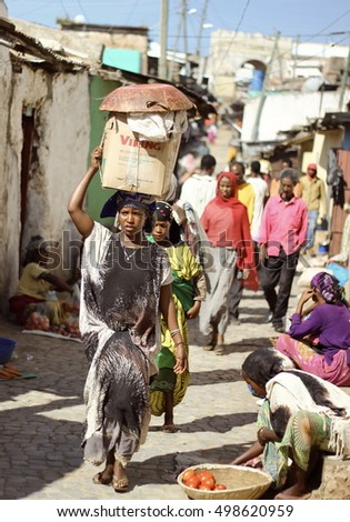 HARAR, ETHIOPIA - CIRCA NOVEMBER 2015: A young Ethiopian women carries her shopping basket on her head.