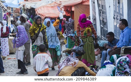 HARAR, ETHIOPIA - DECEMBER 24, 2013: Unidentified people of ancient walled city of Jugol in their daily routine activities that almost unchanged in more than four hundred years. - stock photo