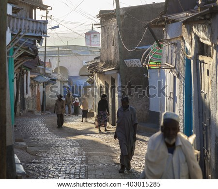 HARAR, ETHIOPIA - DECEMBER 23, 2013: Unidentified people of ancient walled city of Jugol in their morning routine activities that almost unchanged in more than four hundred years. - stock photo