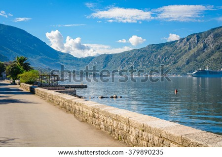 Harbor and ships in sunny day at Boka Kotor bay (Boka Kotorska), Montenegro, Europe.  - stock photo