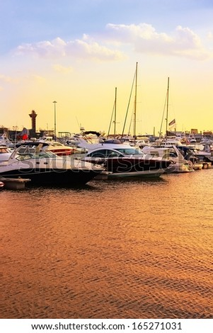 Harbor at sunset. - stock photo