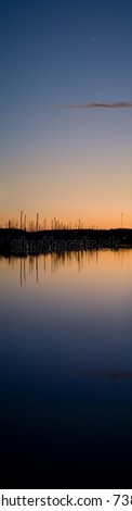Harbor at Sunset with Bright Star Appearing - stock photo