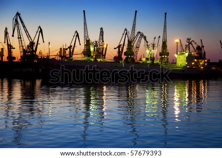 Harbor / Container Terminal / Silhouette of  Cranes at Sunset - stock photo