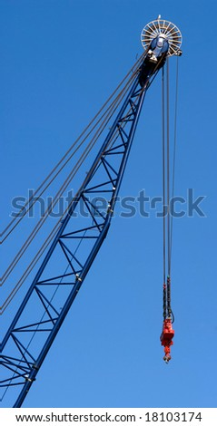 Harbor crane against a deep blue sky.