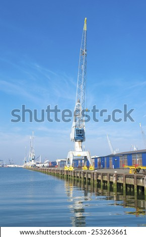harbor cranes in the rotterdam port - stock photo