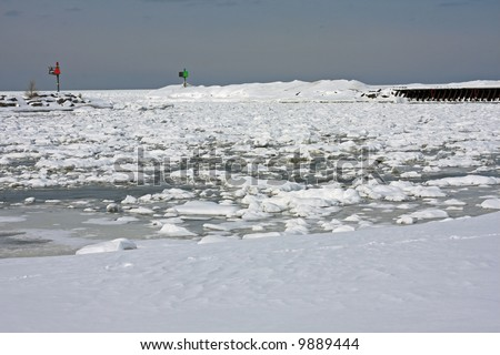 Harbor Entrance from a Frozen Lake Michigan - stock photo
