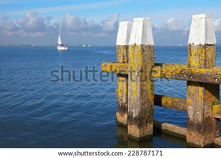 Harbor exit with beautiful white sail yacht seascape backgound  - stock photo