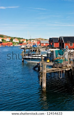 harbor in a small fishing village - stock photo