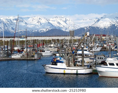 Harbor in Alaska with fishing boats - stock photo