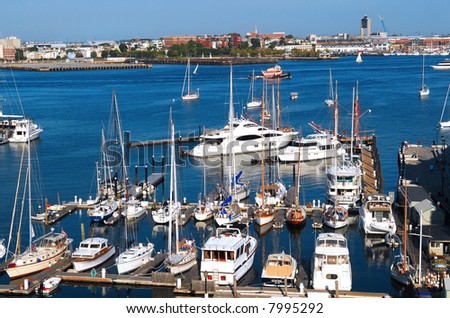 Harbor in Boston Massachusetts with boats on a sunny day - stock photo