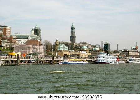 Harbor (Landungsbrücken), river Elbe and church Michel in Hamburg, Germany - stock photo