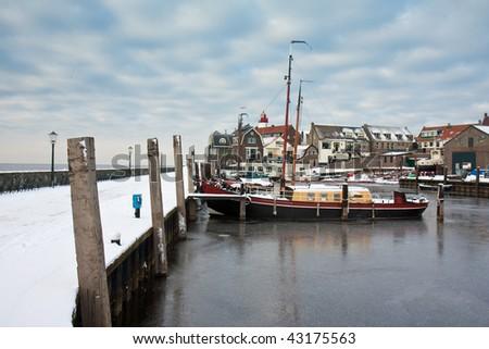 Harbor of Dutch fishery village Urk in wintertime - stock photo