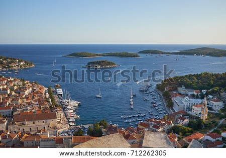 Harbor of old Adriatic island town Hvar. High angle panoramic view. Popular touristic destination of Croatia.