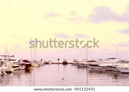 Harbor of Santa Eulalia, Ibiza Island. Yacht harbor after the sunset, blue hour. Pastell colored light and anchored boats, quiet scene. - stock photo