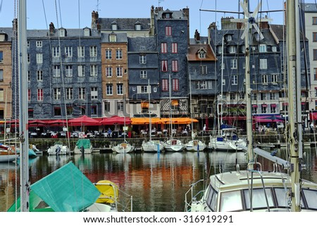 Harbor scene at the beautiful little port of Honfleur in Normandy, France - stock photo