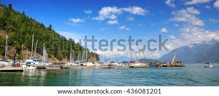 Harbor.Vancouver Island. Pacific ocean bay. Pier of the ships, yachts and boats. Mountains and green forests landscape. Distance view. British Columbia. Canada - stock photo
