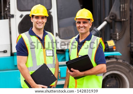 harbor warehouse worker standing in front of container forklift - stock photo