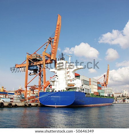 Harbor with blue container ship - stock photo