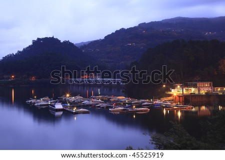 Harbor with boats at Geres - stock photo