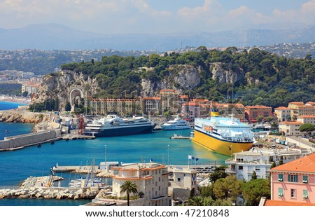 Harbor with luxury yachts, cruise ships of the city of Nice, France. - stock photo