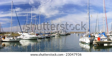 Harbor with yachts and Flagpoles