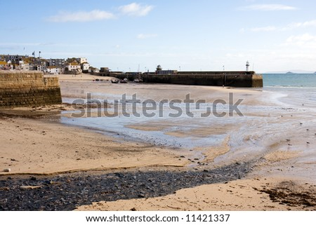 Harbour at Low Tide with Beached Fishing Boats