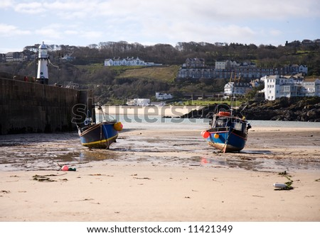 Harbour at Low Tide with Beached Fishing Boats - stock photo
