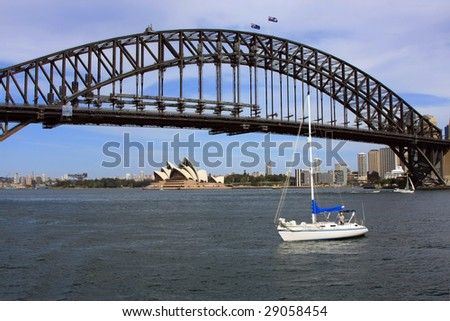 Harbour Bridge in Sydney. Opera House seen in the background - stock photo