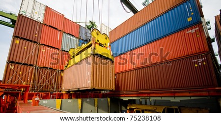 harbour crane lifts container during cargo operation in port - stock photo