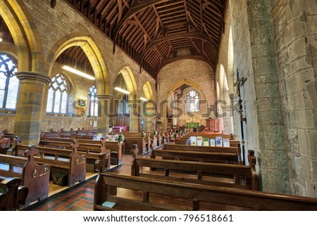 HARBURY, ENGLAND - AUGUST 10, 2012: Interior of the church of All Saints in Harbury in Warwickshire, England. It was first built in the Medieval period, but rebuilt and altered in recent times.