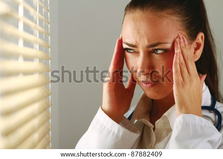Hard day for a doctor - stock photo