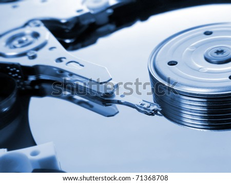 Hard disk drive in blue tone - stock photo