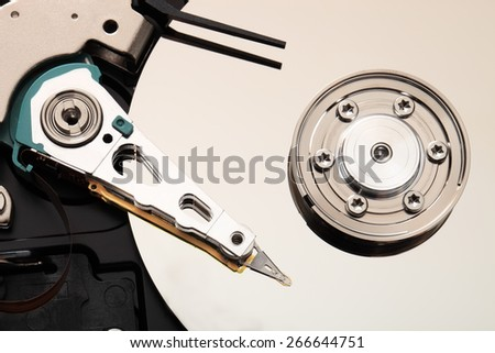 Hard disk drive inside. Data safety concept. - stock photo
