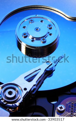 Hard disk drive (toned in blue) - stock photo