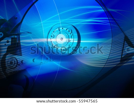 Hard disk drive with an abstract blue background - stock photo
