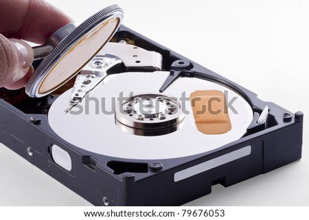 Hard Disk is sick, has a bad track and needs a doctor to retrive the stored information - stock photo