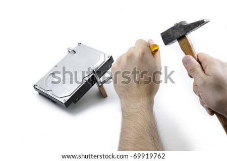 Hard disk locked under attack by two hands with tools on a white background - stock photo