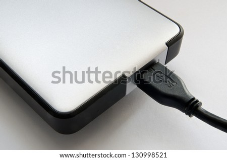 hard disk on a grey background closeup - stock photo