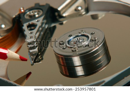 hard disk, writing pencil, writing to the disc.  - stock photo