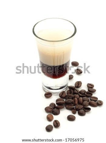 Hard Drink made of three Liqueur: Coffee Liqueur, Cream with Irish Whiskey. Coffee Crop Garnish. Isolated on White Background. - stock photo