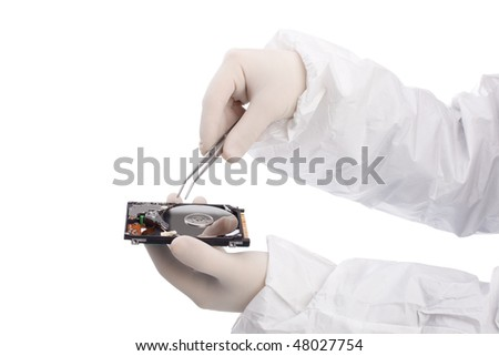hard drive and tweezers in hand isolated on white background - stock photo