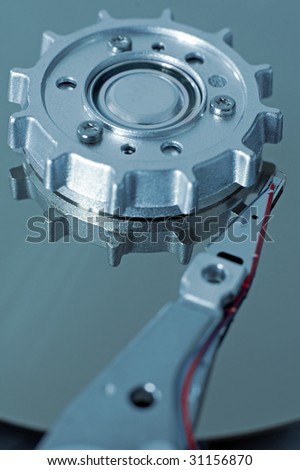 hard-drive head detail photo, cyan colored photo, red wire - stock photo